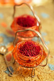 Saffron spice in antique vintage glass bowl Royalty Free Stock Image