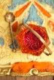 Saffron spice in antique vintage glass bowl Royalty Free Stock Photos
