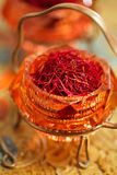 Saffron spice in antique vintage glass bowl Royalty Free Stock Photo