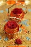 Saffron spice in antique vintage glass bowl Royalty Free Stock Images