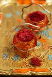 Saffron spice in antique vintage glass bowl Stock Image