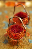 Saffron spice in antique vintage glass bowl, closeup Stock Image