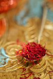 Saffron spice in antique vintage glass bowl, closeup Stock Photos