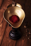 Saffron spice in antique vintage iron scale bowl on wooden table Stock Photos