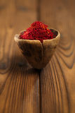 Saffron spice in antique wooden spoon on old wood background, cl Stock Photography