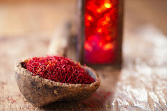 Saffron spice in antique wooden spoon on old wood Stock Photography