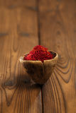 Saffron spice in antique wooden spoon on old wood background Stock Image