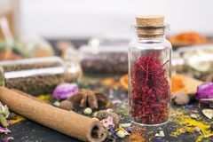 Saffron spice. In glass jars on black Royalty Free Stock Photography