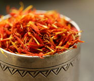 Saffron spice in metal bowl macro shot Royalty Free Stock Images
