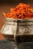 Saffron spice in metal bowl macro shot Stock Images