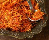 Saffron spice in metal bowl macro shot Stock Photos