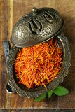 Saffron spice in metal bowl macro shot Royalty Free Stock Photography