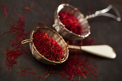 Saffron spice threads and powder  in vintage  old sieve Stock Photos