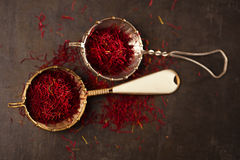 Saffron spice threads and powder  in vintage  old sieve Stock Image