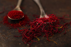 Saffron spice threads and powder  in vintage  old spoons Royalty Free Stock Photography