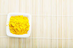 Saffron spice in white dish on mat Royalty Free Stock Photo