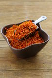 Saffron spice on a wooden background macro shot Royalty Free Stock Images