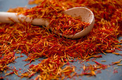 Saffron in a spoon on a dark background, selective focus, macro shot, shallow depth of field Stock Photography