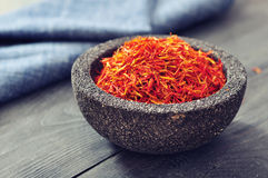 Saffron in stone bowl Royalty Free Stock Photography
