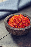 Saffron in stone bowl Royalty Free Stock Images