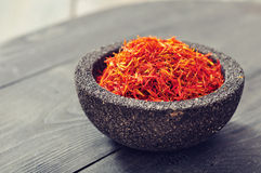 Saffron in stone bowl Stock Images