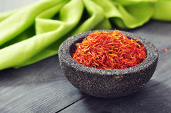 Saffron in stone bowl Royalty Free Stock Image