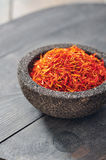 Saffron in stone bowl Royalty Free Stock Photos