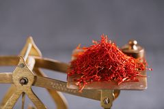 Saffron treads with vintage postal scale royalty free stock photography