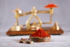 Saffron treads with vintage postal scale royalty free stock photo