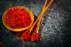 Saffron. Various Indian Spices on black stone table. Spice and herbs on slate background. Cooking stock photography