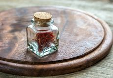Saffron in the vial. On the wooden board Stock Image