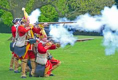 The Redcoats of  Pulteneys  Regiment firing their Muskets. SAFFRON WALDEN, ESSEX, ENGLAND - MAY 01, 2017:  The Redcoats of  Pulteneys  Regiment firing their Royalty Free Stock Photos