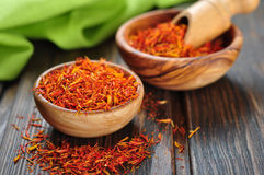 Saffron on wooden background Royalty Free Stock Photos