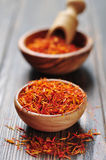 Saffron in wooden bowl Royalty Free Stock Images