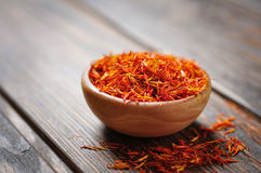 Saffron in wooden bowl Stock Image