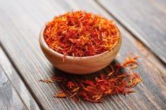 Saffron in wooden bowl Stock Photos