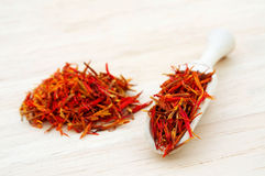 Saffron in wooden scoop Stock Photography