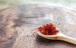 Saffron on the wooden spoon Stock Photo