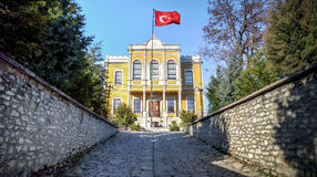 Safranbolu, Turkey - January 20, 2013: Historical government office building in Safranbolu village with Turkish flag. Safranbolu is the best preserved town in stock photo