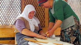 SAFRANBOLU, TURKEY - MAY 2015: woman preparing traditional food, gozleme stock video footage