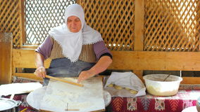 SAFRANBOLU, TURKEY - MAY 2015: woman preparing traditional food, gozleme stock video footage
