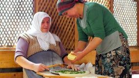 SAFRANBOLU, TURKEY - MAY 2015: woman preparing traditional food, gozleme stock video