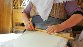 SAFRANBOLU, TURKEY - MAY 2015: woman preparing traditional food, gozleme stock footage