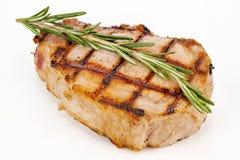 Saftig grillad stek med örten Arkivbilder