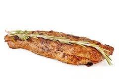 Saftig grillad stek med örten Arkivbild
