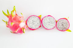 Saftiga Dragon Fruit på vit bakgrund Royaltyfria Bilder