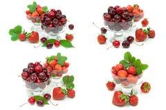 Saftiga körsbär och jordgubbar i glass bunkar på den vita backgrouen royaltyfri foto