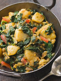 Sag Aloo in a Karai Pan stock photos