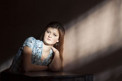 Sag girl sitting alone Royalty Free Stock Photos