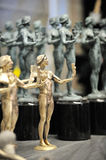 SAG Statuettes. Casting and production of the solid bronze Actor statuettes - the trophies for the Screen Actors Guild Awards - at American Fine Arts Foundry in Royalty Free Stock Photography